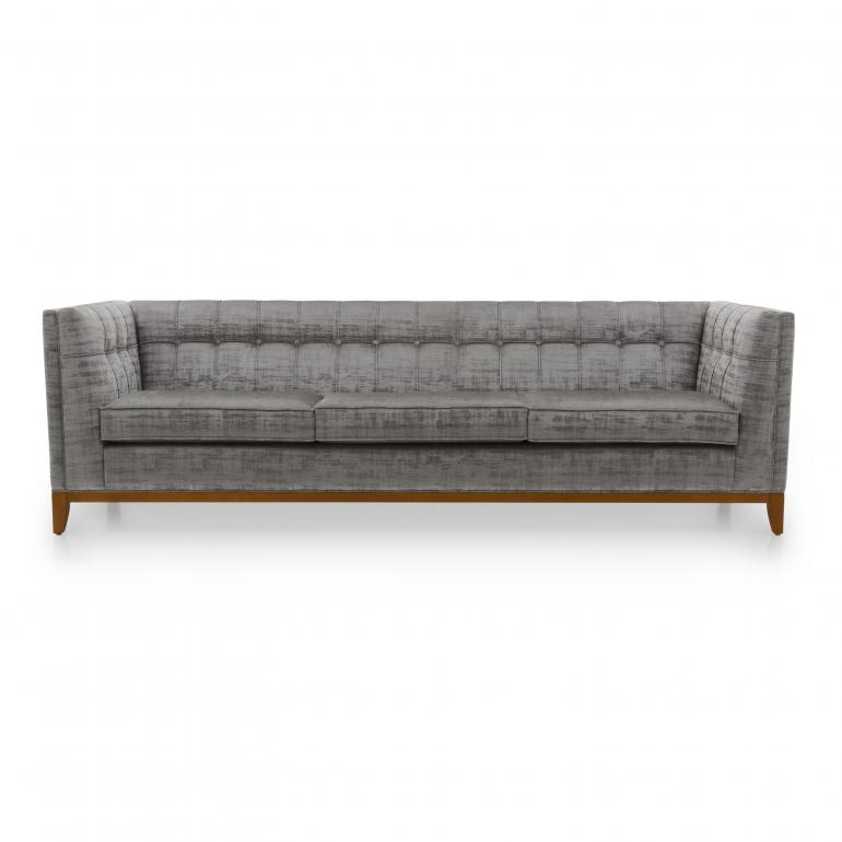 Large contemporary sofa with buttoned back, upholstered in silver/grey velvet with cherry wood base