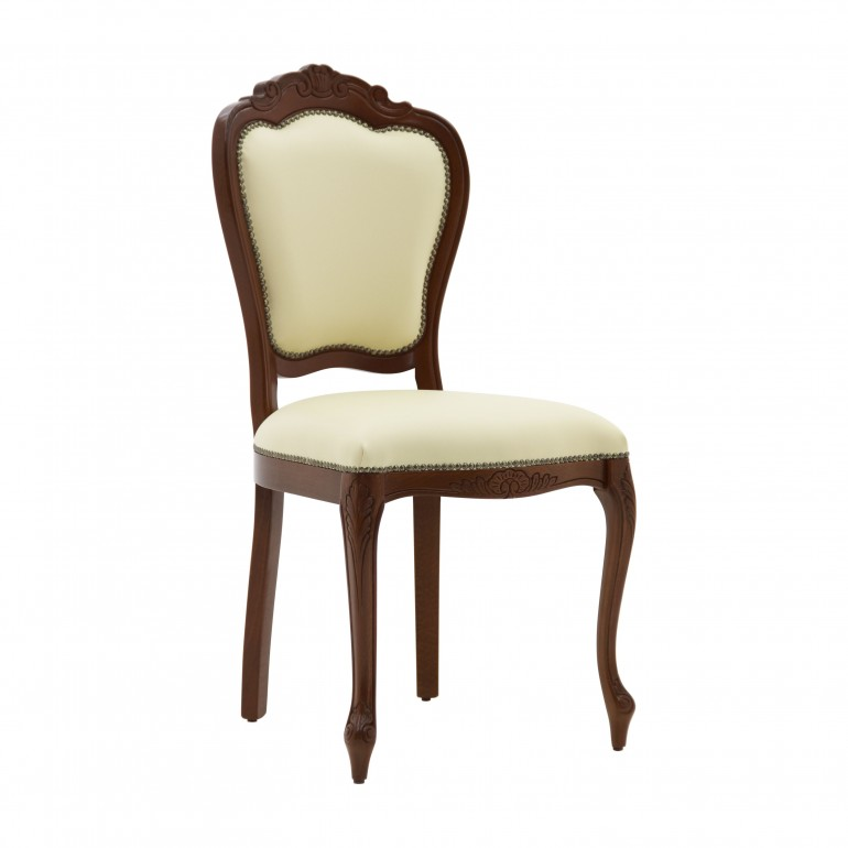 ìClassic replica chair Miledi in baroque style by Sevensedie - solid beech wood frame - comfortable padded back - Polished in a traditional walnut color - trimmed with old gold nails -  upholstered with an elegant cream leather