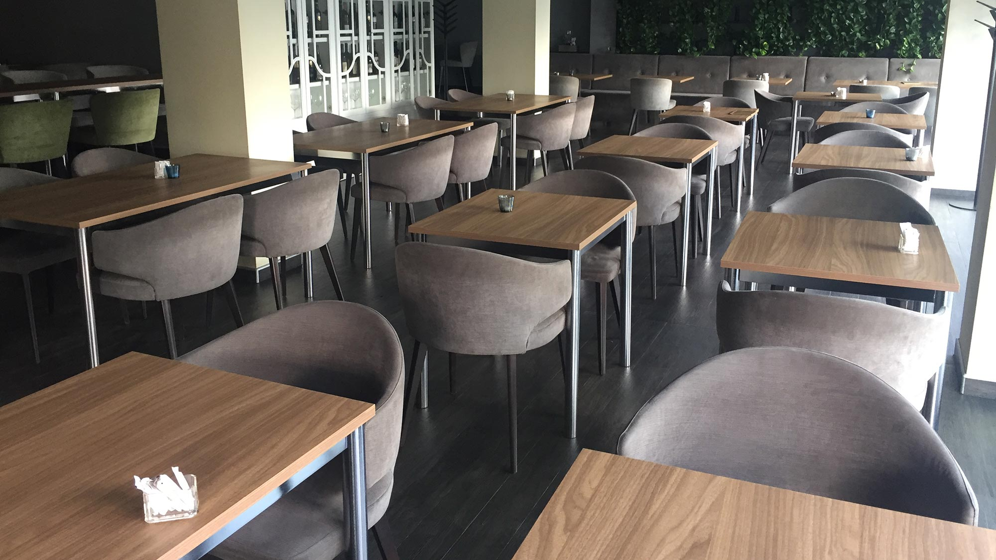 Eva armchair produced in Italy by Sevensedie for a restaurant with small square and rectangular tables
