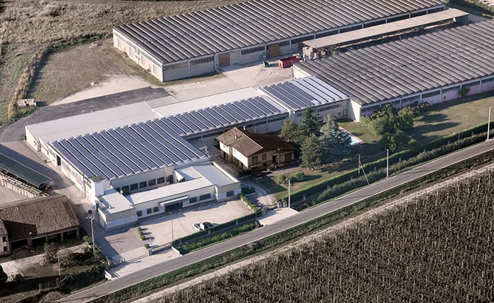 Air view of the Sevensedie headquarters in Verona, Italy. The roof of the building is occupied by solar panels