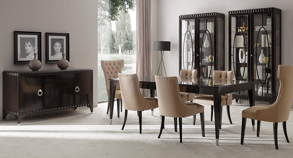 Contemporary Italian dining room made of a  rectangular, extendible 4 legs wooden dining table in dark brown finish together with 6 leather chairs with deep buttoned back. On the back wall two display cabinets with glass shelves and a 2-door sideboard.