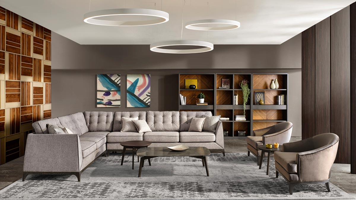 Sectional italian corner sofa Mystirio with 2 armchairs, marble coffee tables and modern open bookcase on the far wall