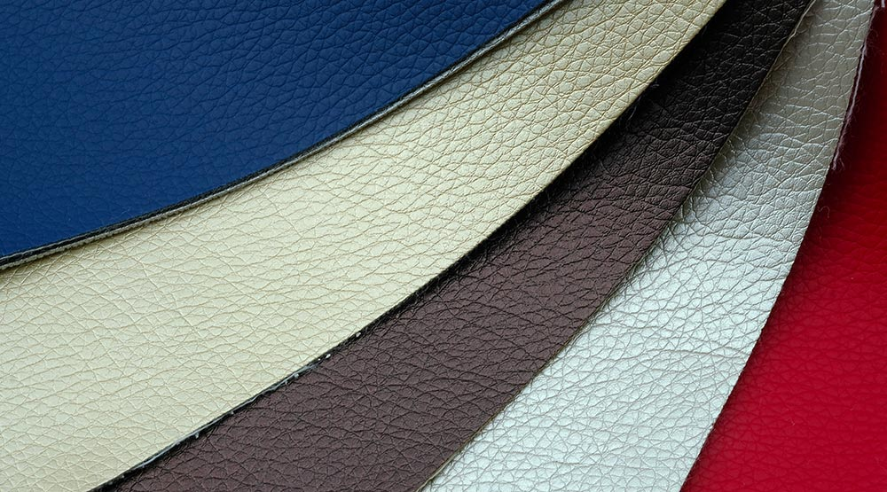 many pieces of faux leather for sale in different colors: white, back, blue, orange, yellow, green purple