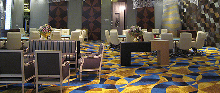 Louis style armchairs and sofa upholstered in a silver stripe fabric in the Seven Luck Casino in Seoul, South Korea