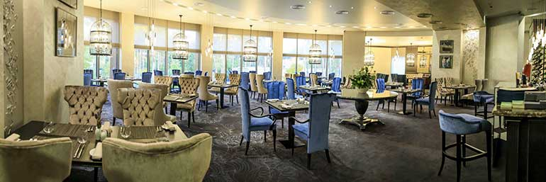 View of the contemporary chairs Queen, Arturo bar stools and Biscotus round dining table by Sevensedie in the hall of the Grand Admiral Resort & SPA in Ukraine