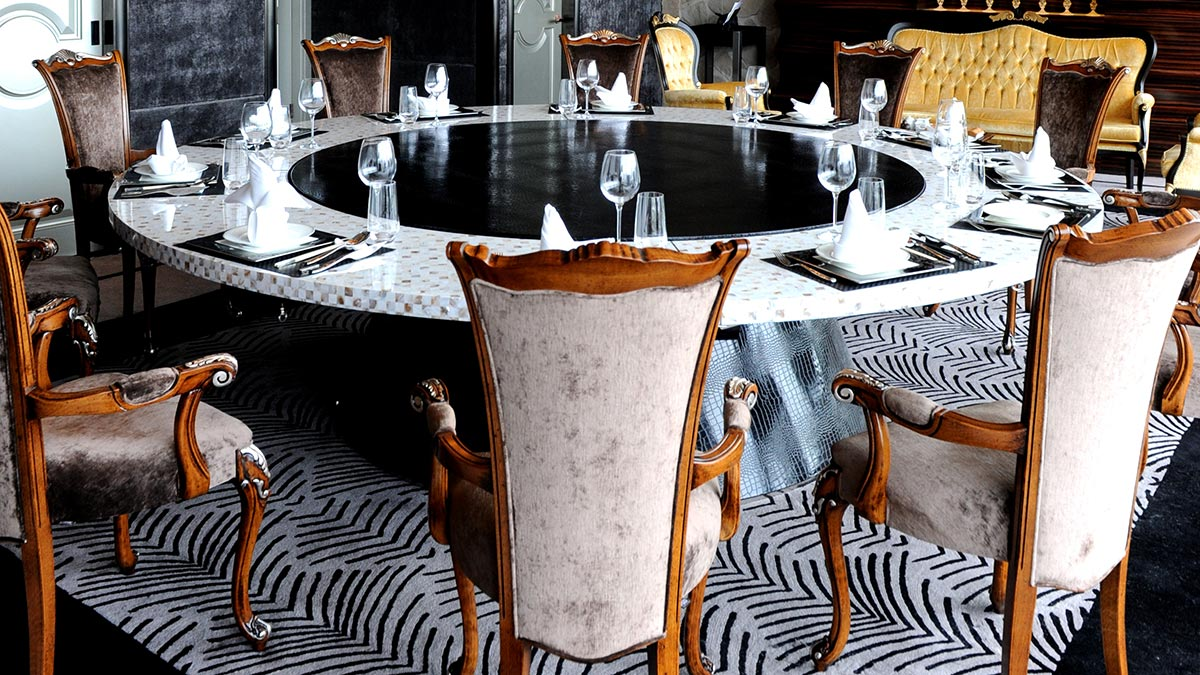 A set of classic Chiara chairs by Sevensedie around a large round table at the Imperial Seal restaurant in Shanghai