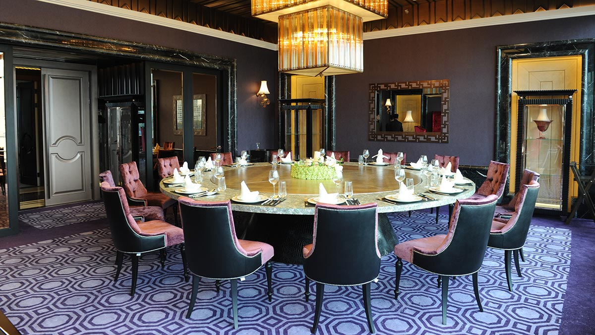 Ramses dining chairs by Sevensedie around a large round table in a private room at the Imperial Seal restaurant in Shanghai