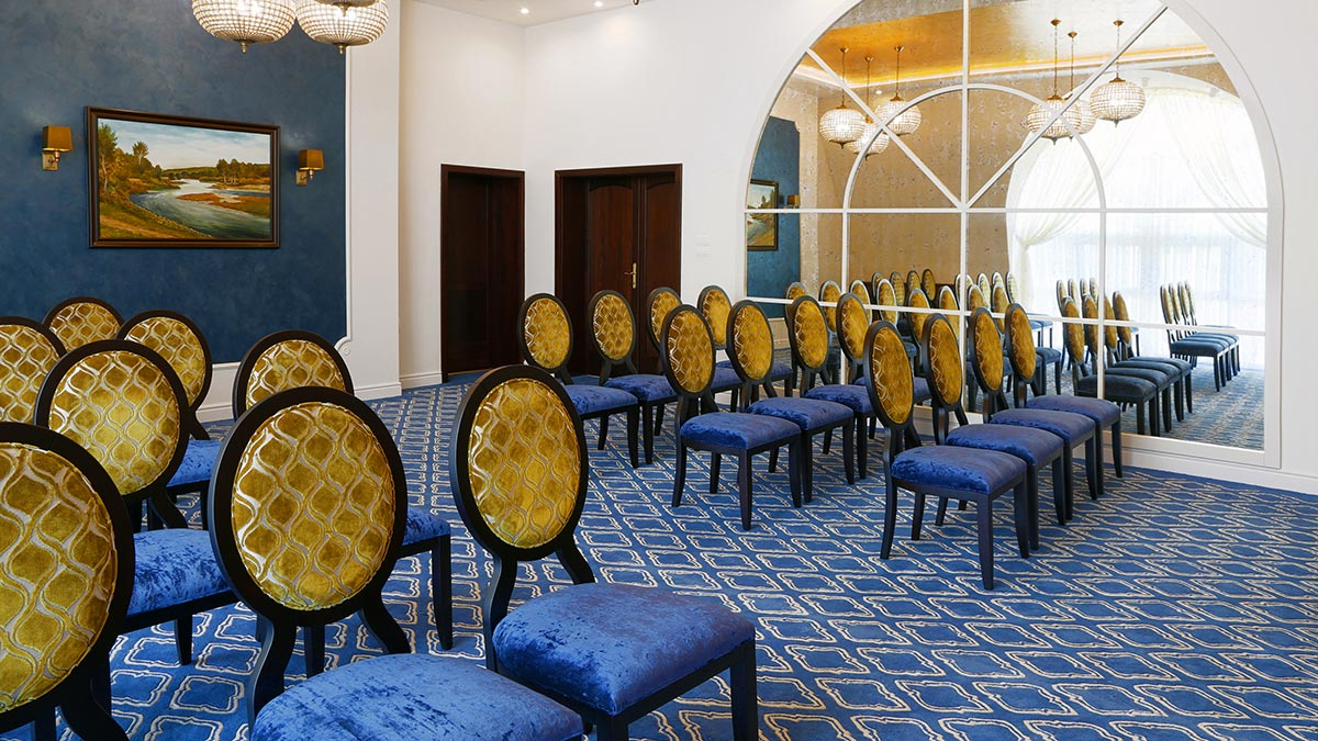 Series of blue contemporary chairs Anello made by Sevensedie in the ceremonial hall of Madunice municipality building in Slovakia