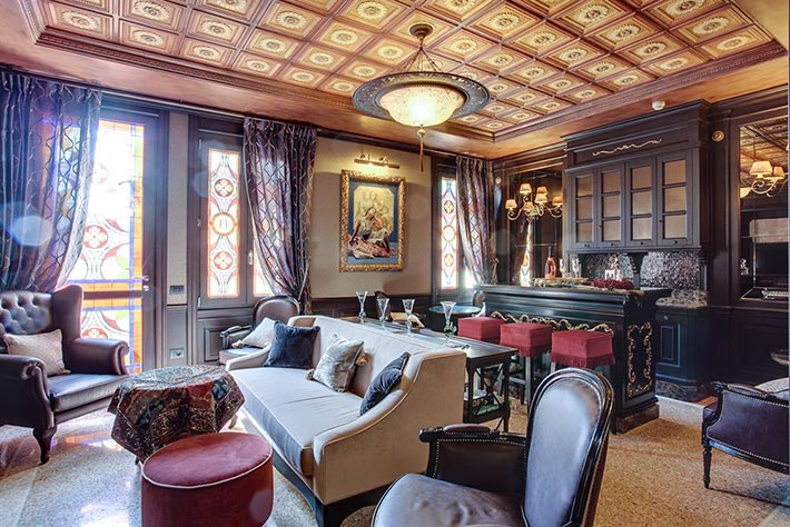 Giunone sofa, Old England leather armchair and Eolo bar stool by Sevensedie in the tea room of the hotel Moresco in Venice, Italy