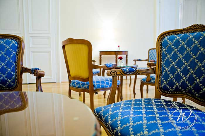 Zeta replica armchairs in baroque style in blue and yellow fabric in the hall of the private dance academies in Vienna, Austria