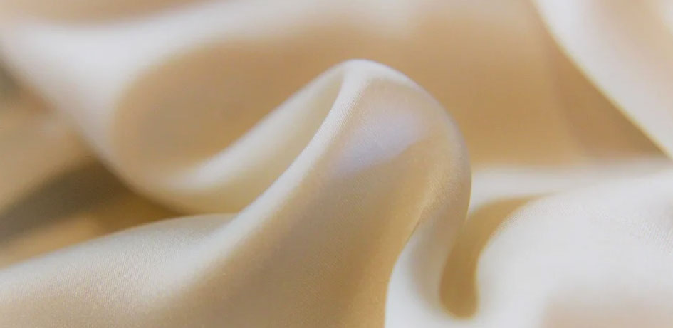 Creamy white satin cotton fabric